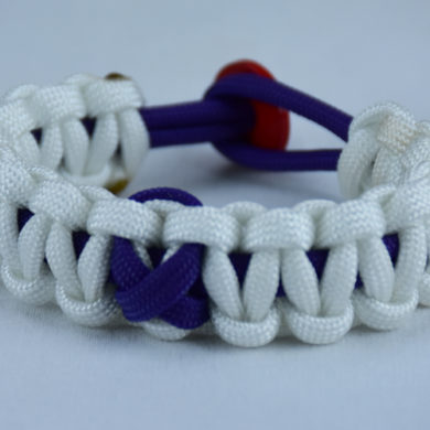purple and white alzheimers support paracord bracelet with red button in the back and a purple ribbon