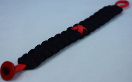 red and black heart disease support paracord bracelet with red button in the corner and red ribbon