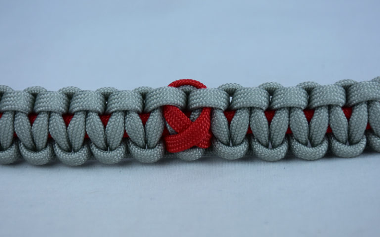 red and grey heart disease support paracord bracelet with red ribbon in the center
