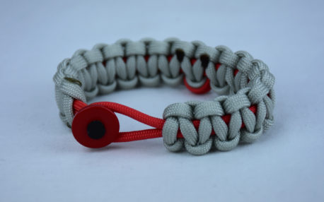 red and grey heart disease support paracord bracelet with red button front and red ribbon