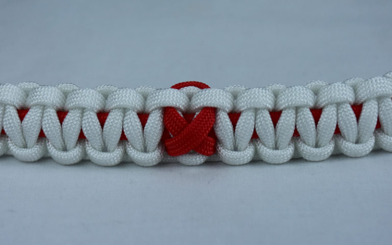 red and white heart disease support paracord bracelet with red ribbon center