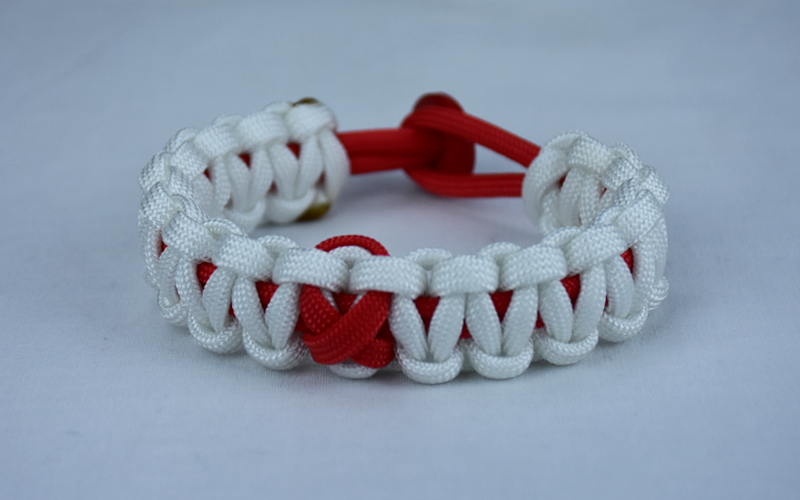 red and white heart disease support paracord bracelet with red button back and red ribbon