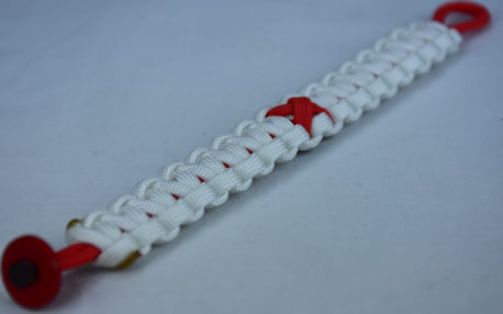 red and white heart disease support paracord bracelet with red button in the bottom corner and red ribbon
