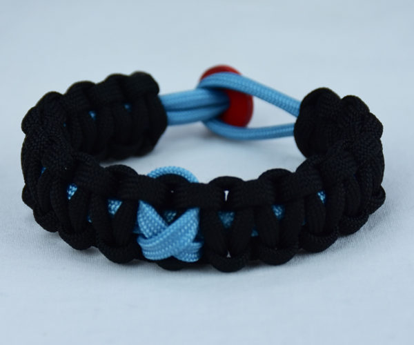 tarheel blue and black prostate support paracord bracelet with red button back and tarheel blue ribbon