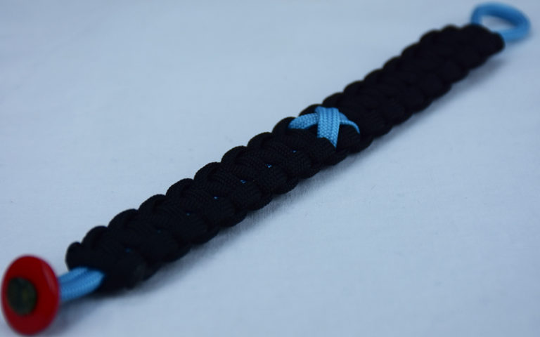 tarheel blue and black prostate cancer support paracord bracelet with red button in the bottom corner and tarheel blue ribbon