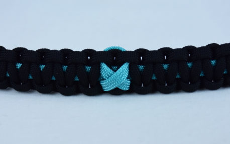 teal and black ptsd support paracord bracelet with teal ribbon in the center