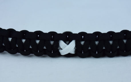 white and black multiple sclerosis support paracord bracelet with white ribbon center