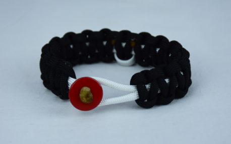 white and black multiple sclerosis support paracord bracelet with red button in the front and white ribbon