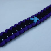 white purple and black prostate cancer support paracord bracelet with red button in the bottom corner and tarheel blue ribbon